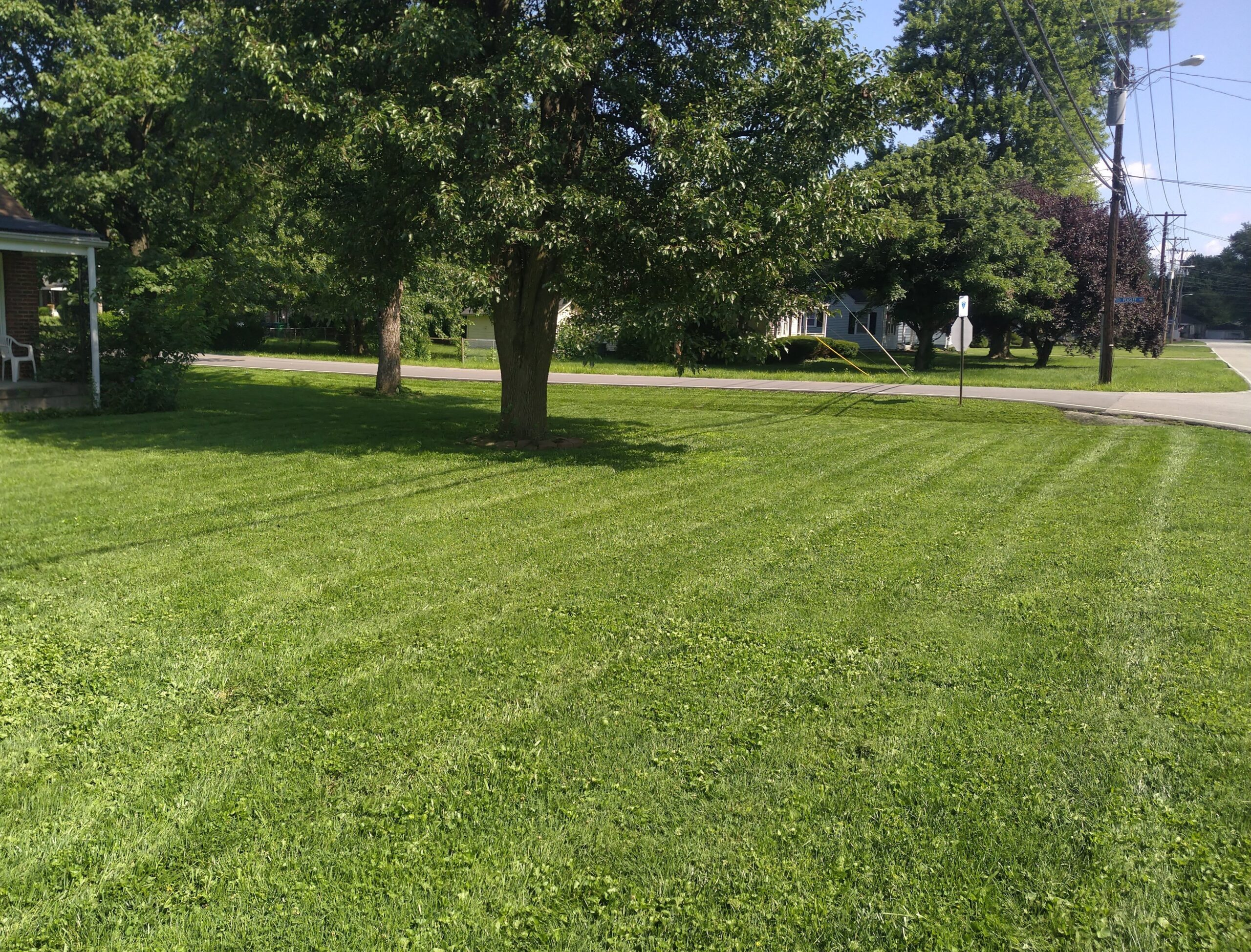 A residential home in Shively that has been serviced by ELCS. The grass has been recently mowed and all clippings have been cleaned up. There are visible mowing stripes in the grass.