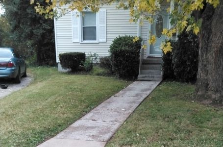 A small residential lawn that has been mowed and cleared of all clippings by ELCS.