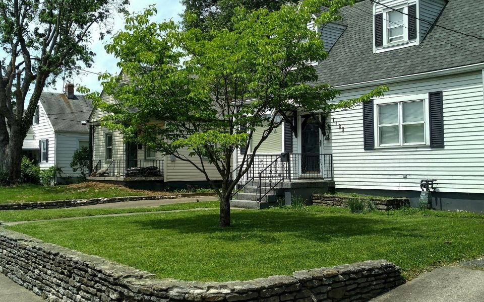 A residential home in Louisville that has been recently serviced by ELCS. The grass has been neatly mowed and all clippings have been cleaned up.