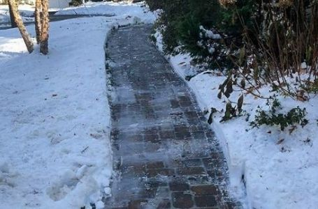 A walkway leading to a residential home that has been cleared of snow by ELCS.
